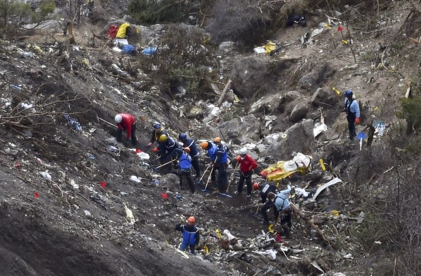 -- AFP PICTURES OF THE YEAR 2015 -- French gendarmes and investigators work on March 26, 2015 in the scattered debris on the crash site of the Germanwings Airbus A320 that crashed in the French Alps above the southeastern town of Seyne. The young co-pilot of the doomed Germanwings flight that crashed on March 24, appears to have