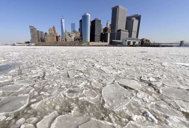 -- AFP PICTURES OF THE YEAR 2015 -- A view of Lower Manhattan from the Staten Island Ferry February 25, 2015 as the New York Harbor is filled with large chunks of ice. Heavy ice in the East River shut down commuter ferry service on Tuesday morning stopping travel between Manhattan, Queens, and Brooklyn. AFP PHOTO / TIMOTHY A. CLARY