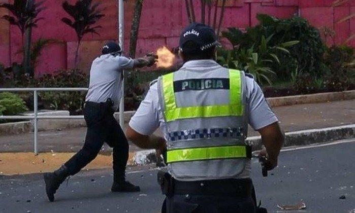 policial arma de fogo manifestação