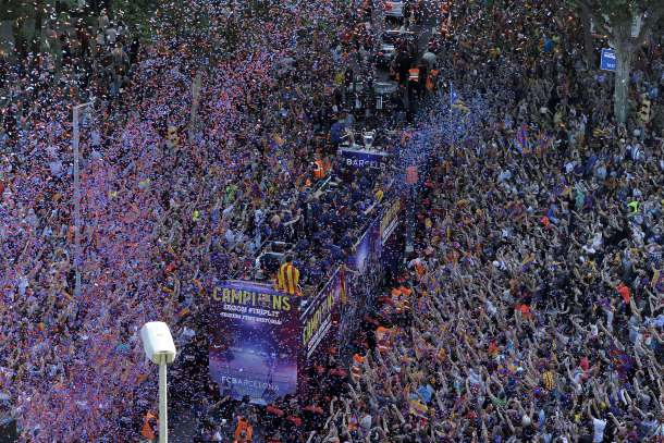 -- AFP PICTURES OF THE YEAR 2015 -- FC Barcelona players parade on a bus through the streets of Barcelona as they celebrate their victory over Juventus one day after the UEFA Champions League final football on June 7, 2015. Luis Suarez and Neymar scored second-half goals to give Barcelona a 3-1 Champions League final victory over Juventus on June 6, 2015 as the Spaniards became the first team to twice win the European treble. AFP PHOTO/ JOSEP LAGO