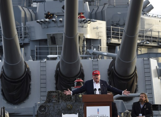 -- AFP PICTURES OF THE YEAR 2015 -- Republican presidential candidate Donald Trump gives a national security speech aboard the World War II Battleship USS Iowa, September 15, 2015, in San Pedro, California. AFP PHOTO /ROBYN BECK