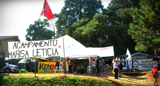 momentos que antecederam tiros ao acampamento pró-Lula