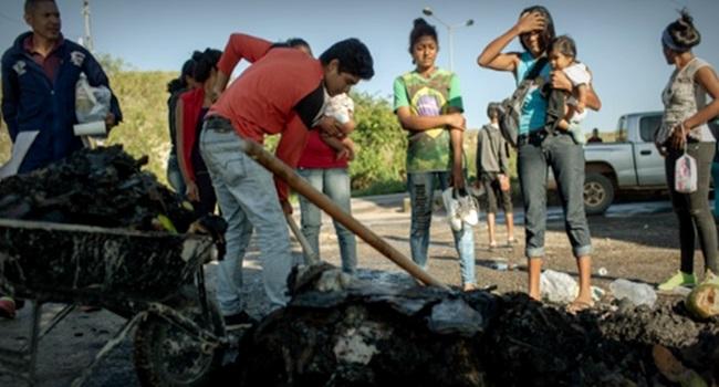 pessoas queimando pertences venezuelanos crianças imigrantes roraima Pacaraima