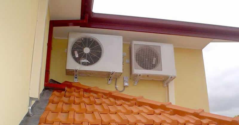 homem baleado telhado ar-condicionado