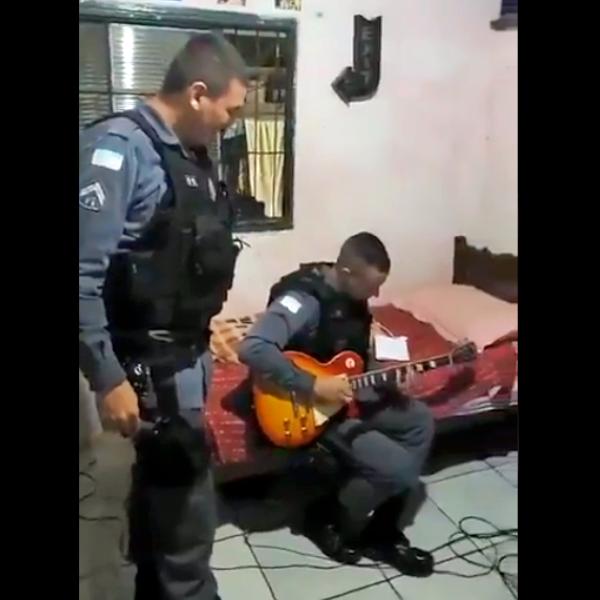 PM toca guitarra irmão de traficante prisão espiríto santo